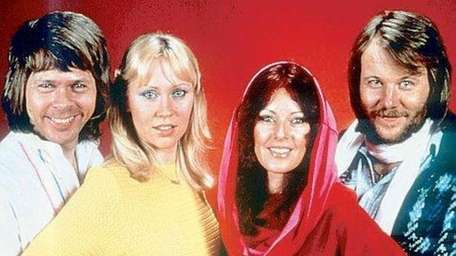 Members of the Swedish rock group ABBA in