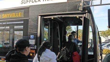 Passengers board a Suffolk County Transit Bus in
