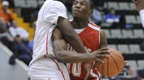 Friends Academy's Tyrone Perkins is fouled by Middle