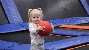 Sophia Tackett, 2, of Lindenhurst, plays at the