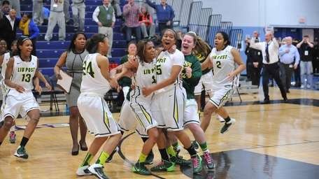 LIU Post teammates swarm Alexis Peters after she