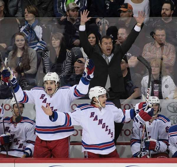 Head coach Alain Vigneault of the Rangers jumps
