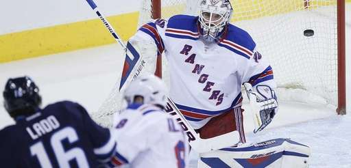 Winnipeg Jets' Andrew Ladd scores on Rangers' goaltender