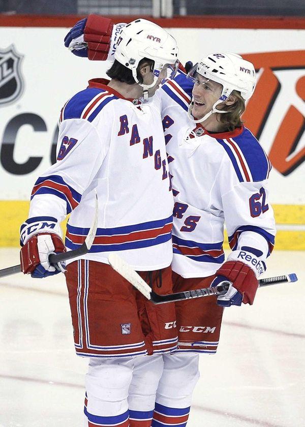 Rangers' Carl Hagelin and Benoit Pouliot celebrates Pouliot's