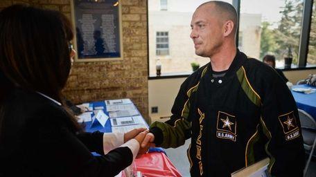 Iraq war veteran Randal Jernigan, of Huntington, shakes