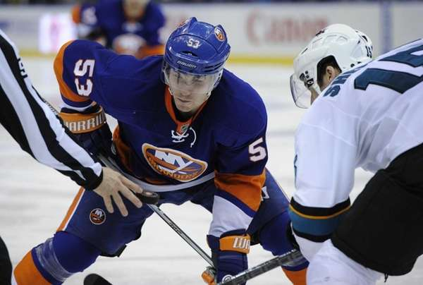Islanders center Casey Cizikas faces off against San