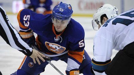 Islanders center Casey Cizikas faces off against San