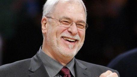 Phil Jackson smiles prior to their NBA basketball