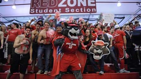 The Stony Brook mascot Wolfie and fans cheer