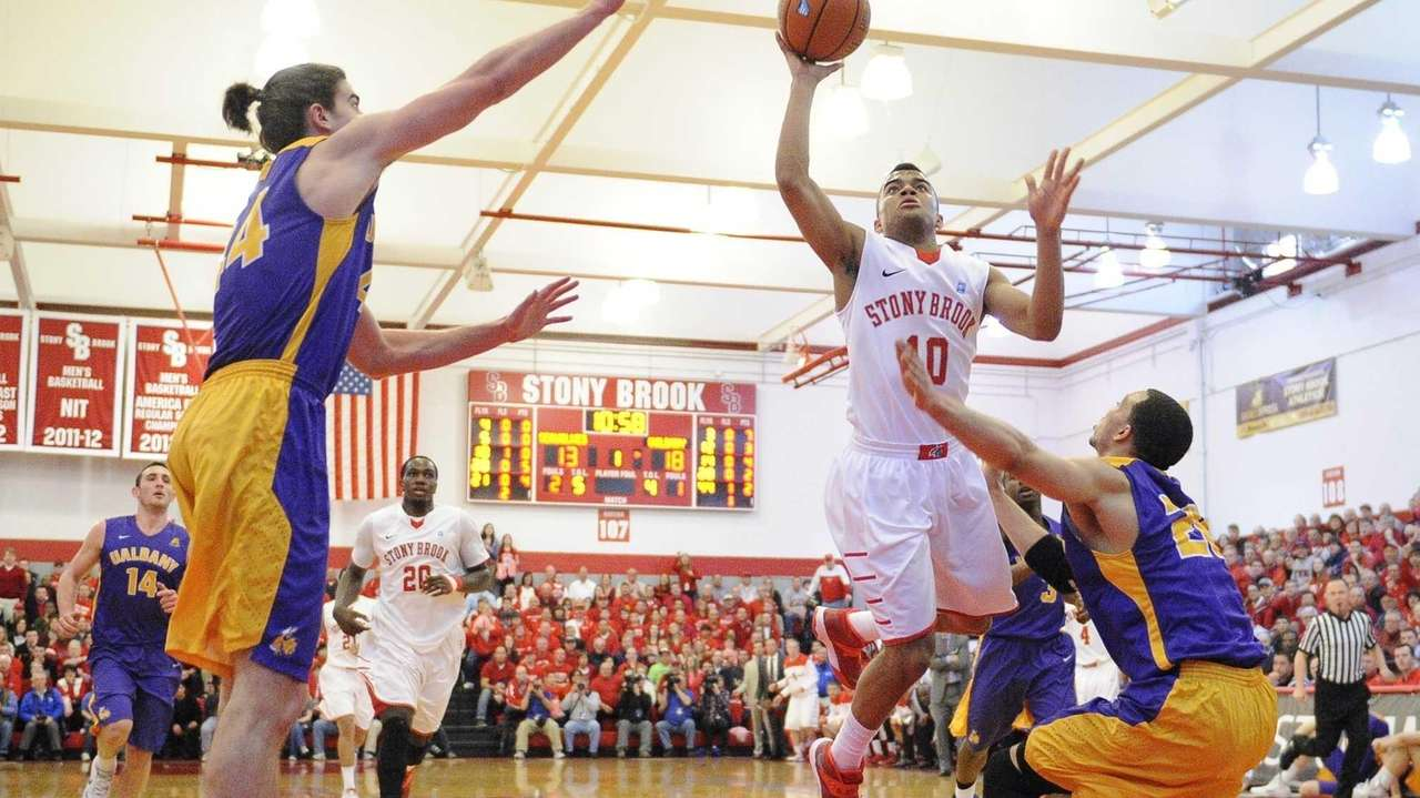 Stony Brook guard Carson Puriefoy shoots against Albany