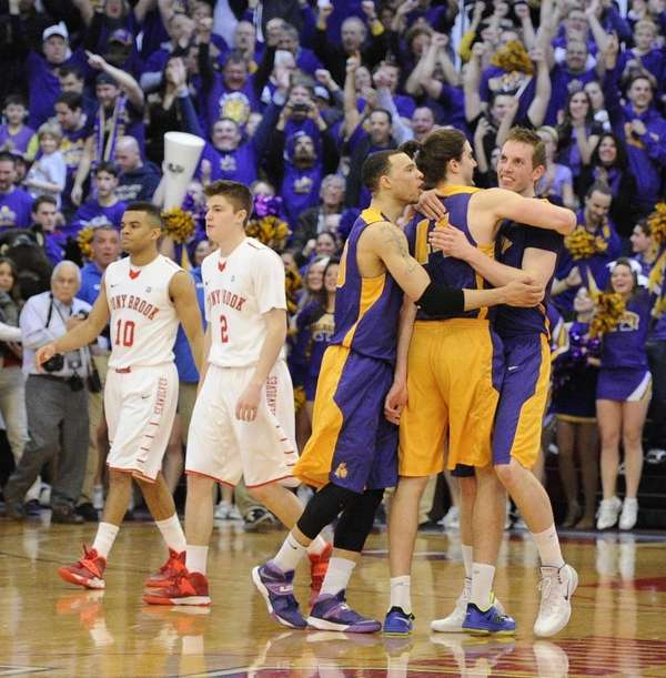 Albany celebrates their 69-60 win as Stony Brook