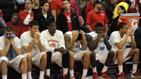 Stony Brook's bench and fans reacts in the