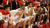 Stony Brook players watch their NCAA Tournament hopes