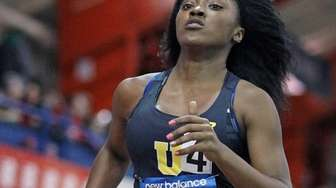 Uniondale's Crystal Green runs in the 3rd leg