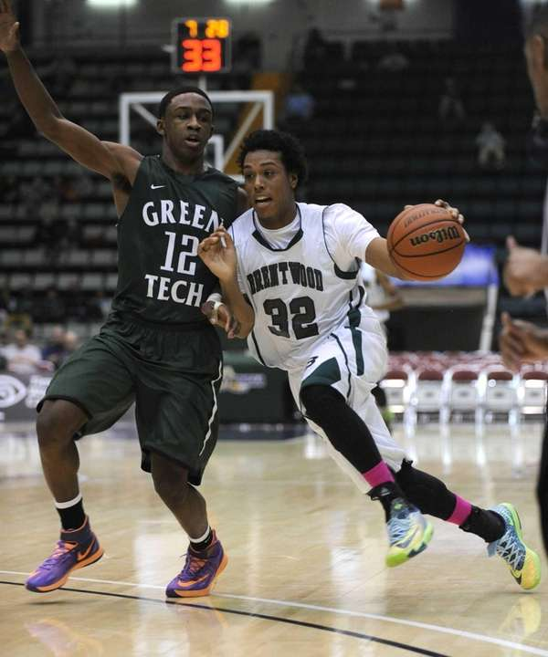 Brentwood's Marcus Hall drives past Green Tech's Jamil