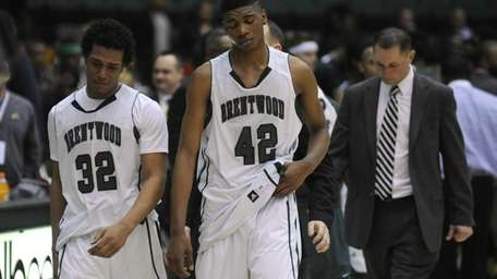 Brentwood's Marcus Hall and Jamel Allen react after