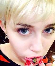 "Miley Cyrus shows off her ""Sad Kitty"" tattoo."