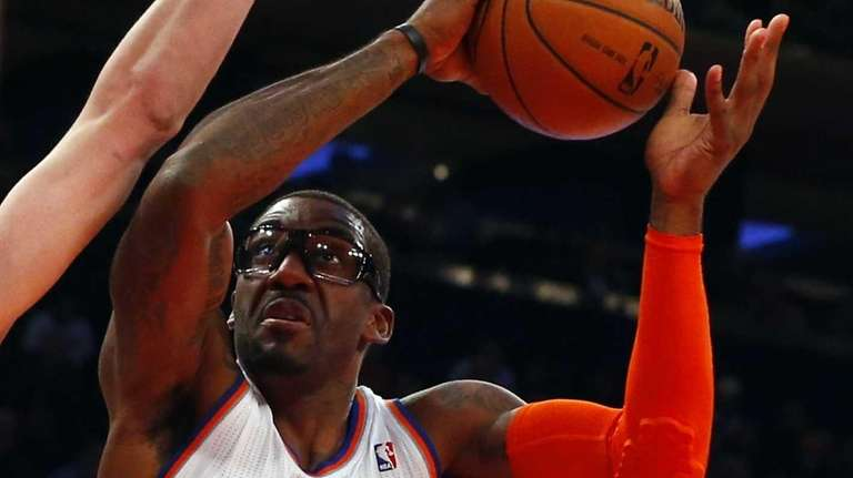 Amar'e Stoudemire of the Knicks goes to the