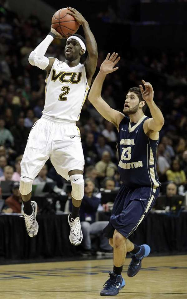 VCU's Briante Weber, left, shoots while George Washington's