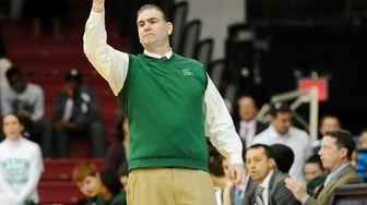Holy Trinity head basketball coach Joe Conefry reacts
