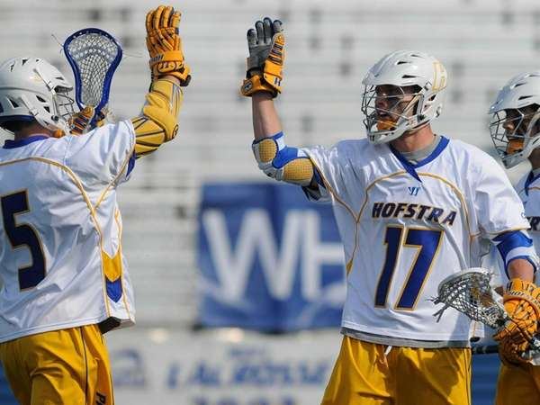 Hofstra's Torin Varn, right, congratulates teammate Sam Llinares