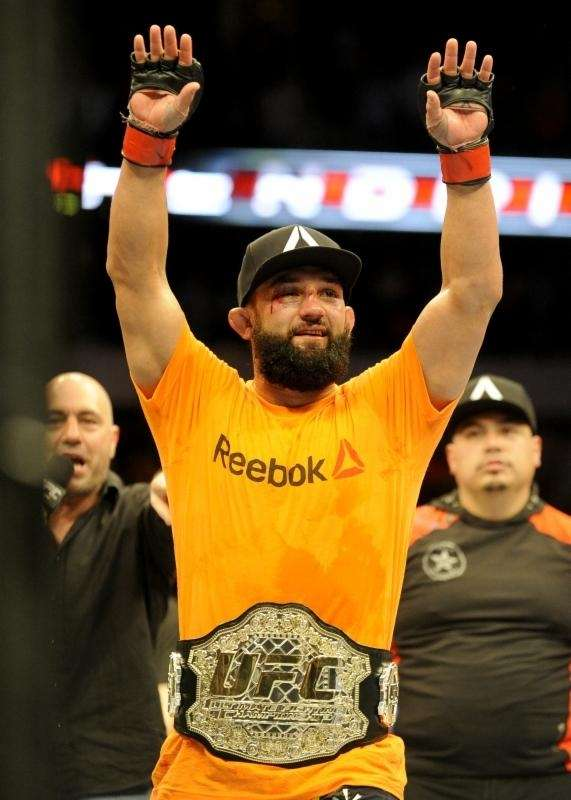Johny Hendricks celebrates after beating Robbie Lawler during