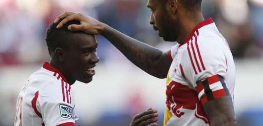 Red Bulls forward Thierry Henry, right, celebrates with