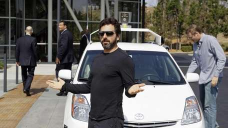 Google co-founder Sergey Brin gestures after riding in