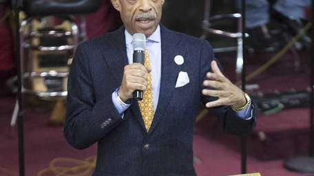 The Rev. Al Sharpton speaks during services Sunday,