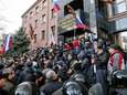 Pro-Russia demonstrators storm the prosecutor-general's office during a