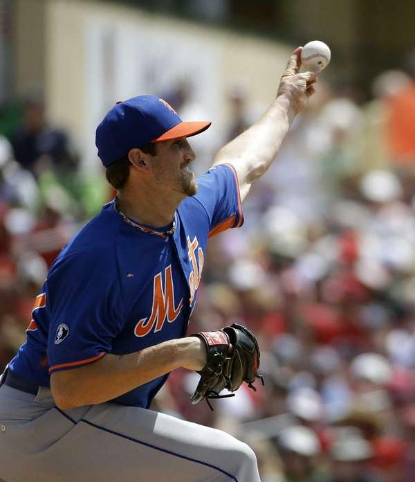 Jonathon Niese delivers a pitch in the first