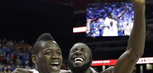 Florida forward Will Yeguete (15) and Patric Young