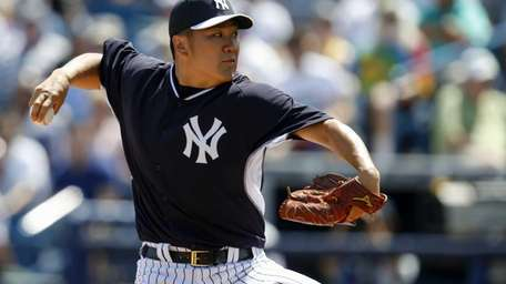 Masahiro Tanaka delivers a pitch during a spring
