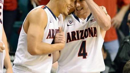Nick Johnson #13 and T.J. McConnell #4 of