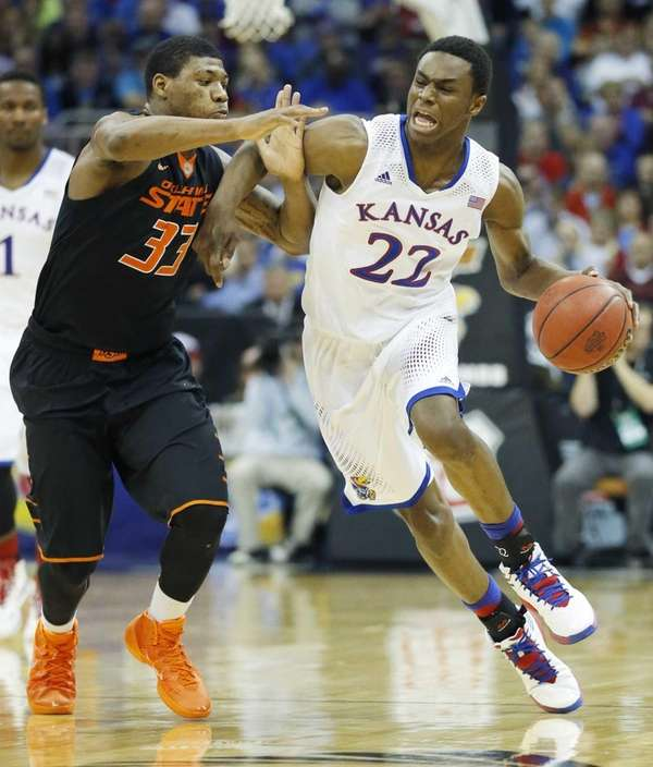 Kansas guard Andrew Wiggins is covered by Oklahoma