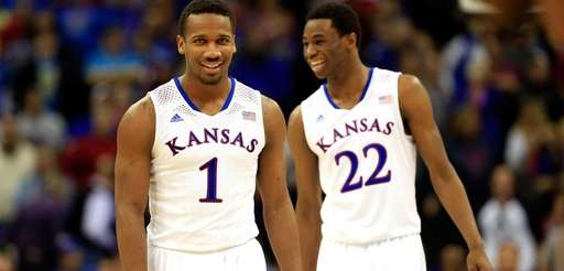 Kansas Jayhawks' Wayne Selden, Jr. celebrates with teammate