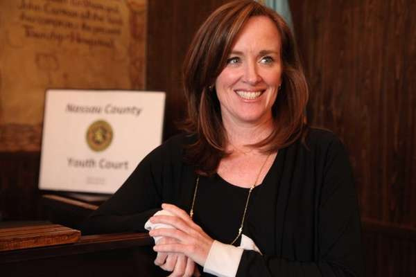Nassau County District Attorney Kathleen Rice celebrates the