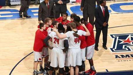 The Louisville Cardinals huddle together before a game