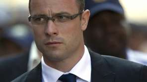Oscar Pistorius arrives at the high court for