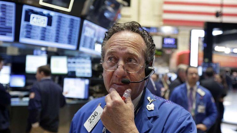 Trader Steven Kaplan works on the floor of
