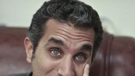 Egyptian satirist Bassem Youssef speaks during an interview