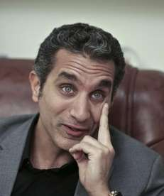 Egyptian satirist Bassem Youssef speaks during an interview
