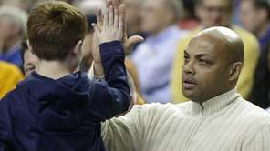 Former NBA basketball player Charles Barkley, right, greets