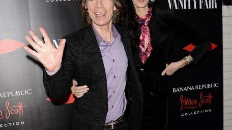 Mick Jagger and fashion designer L'Wren Scott arrive
