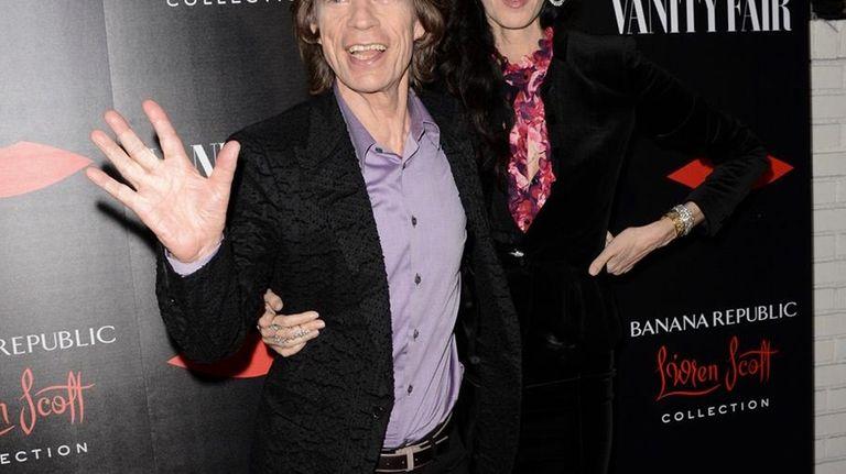 Mick Jagger and fashion designer L'Wren Scott arrive