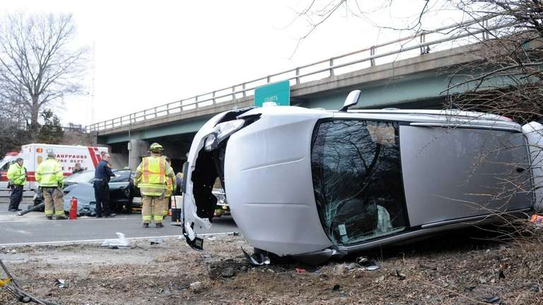 Firefighters at the scene of two-vehicle crash that