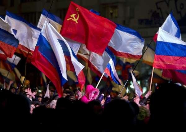 Pro-Russian people celebrate in Lenin Square, in Simferopol,