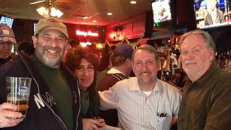 Bill Fotheringham, 52, of Rockville Centre, (second from