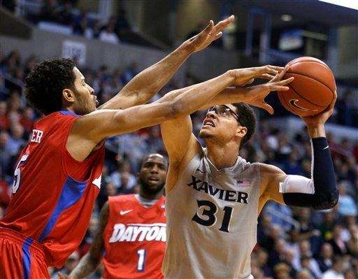 Xavier forward Isaiah Philmore (31) looks to shoot