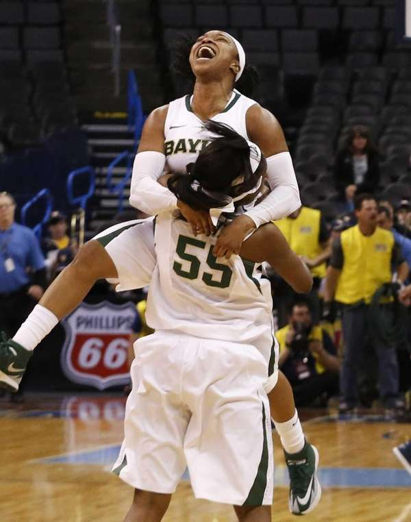 Baylor guard Odyssey Sims (0) celebrates with point